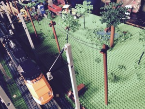 LEGO train passing a cow farm