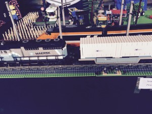 LEGO trains passing a combine harvester and corn field